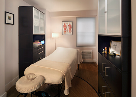 Manhattan Acupuncture Massage Therapy, Massage Therapist bed